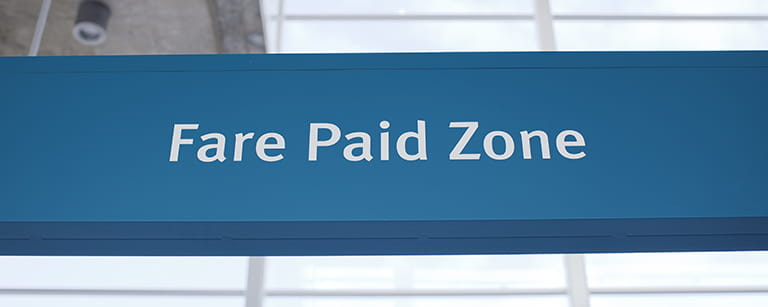 A sign that says fare paid zone