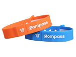 orange and blue compass wristbands next to each other