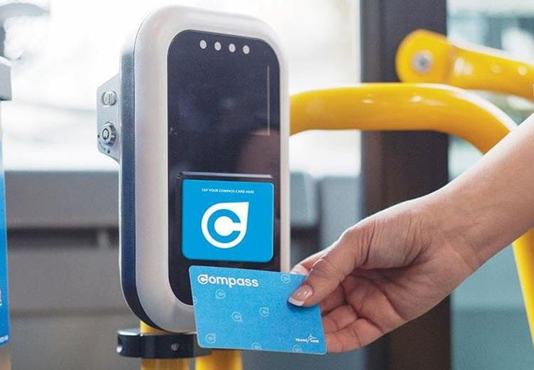 Compass Card being tapped by a card reader